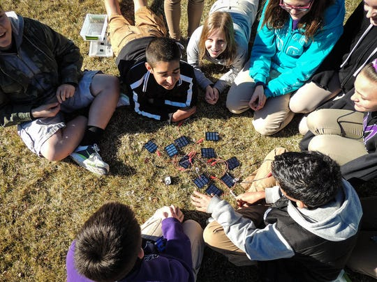 Students at Mendive Middle School in Sparks play with and learn about miniature solar energy panels.