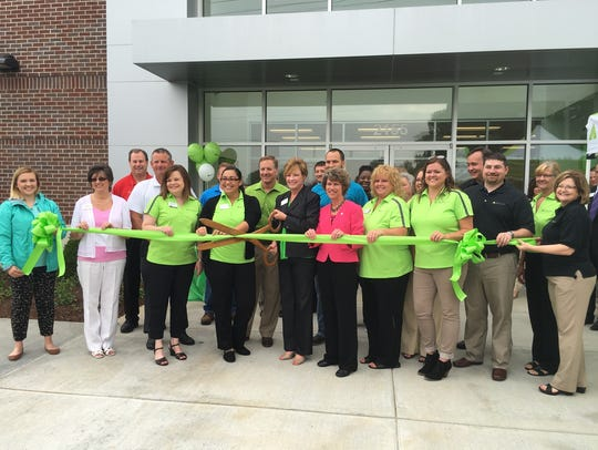 Regions Bank and community leaders cut the green ribbon
