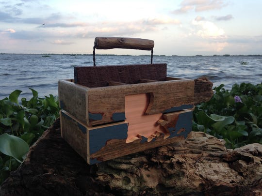 Scott Bergeron creates some amazing Louisiana themed six pack carriers from reclaimed wood.