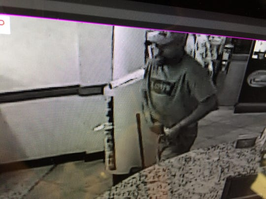 Police are searching for this suspect in the theft of a cancer research donation jar in Deptford.