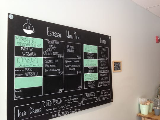 The menu board at Onyx Tonics on College Street in