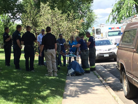 Hazmat crews work to determine the substance that caused