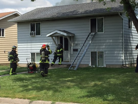 Firefighters enter a north St. Cloud home just before