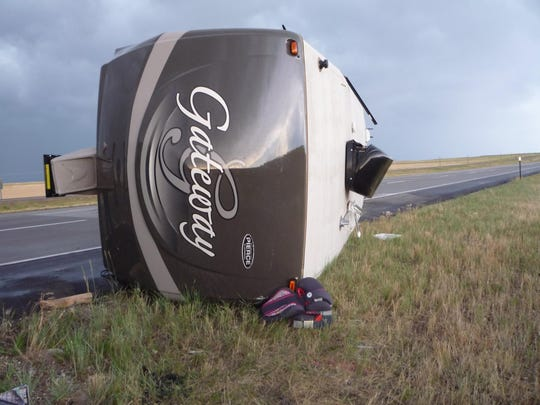 This camper was toppled by strong winds that pushed