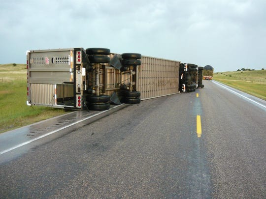 This semi was toppled by strong winds that pushed through