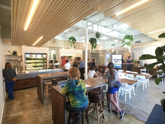 The Greenville Happy + Hale will be similar to the Durham store, with a bright, inviting interior and a mix of community tables and bar seating.