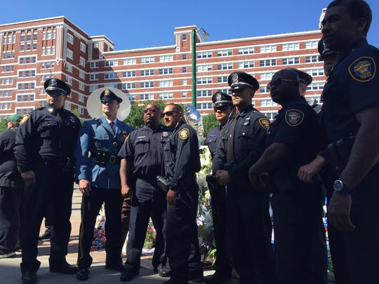 Roxbury Sgt. Sean Hefferon and Patrolman Tom Denicola stand with Dallas officers at the funeral of Sgt. Michael Smith.