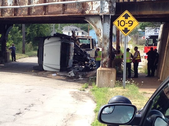 A truck lies on its side after striking the Upton Avenue