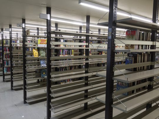 Empty shelves are seen last month at the downtown Reno library as it prepares for remodeling.