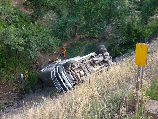 This pick up and horse trailer rolled down an embankment