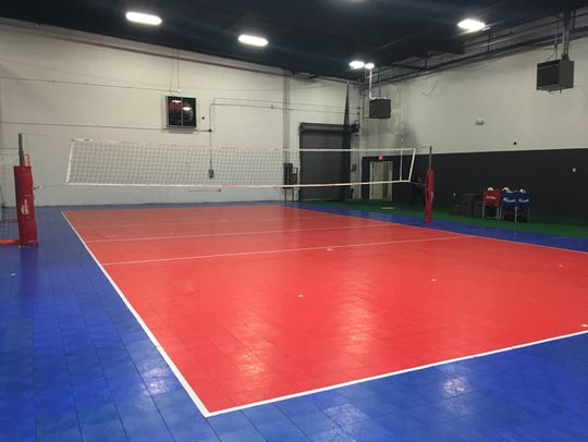 Acme Athletics' indoor volleyball court