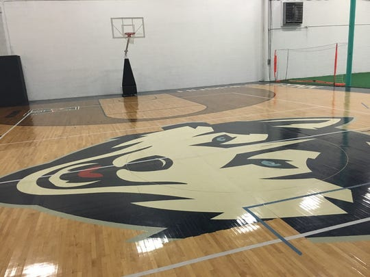 Acme Athletics has reclaimed an authentic University of Connecticut Huskies basketball floor for local kids to learn the game on. It's in good shape, and it's a popular novelty.