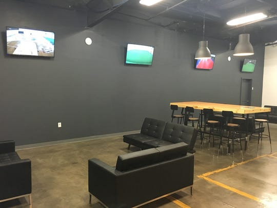 The lobby area of Acme Athletics features TV monitors where parents or guardians can relax and watch their child being trained in various sports.