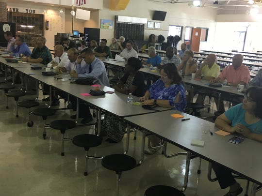 Attendees at Kenwood High School on Tuesday evening, including some local elected officials, record their thoughts about a public library for north Clarksville.