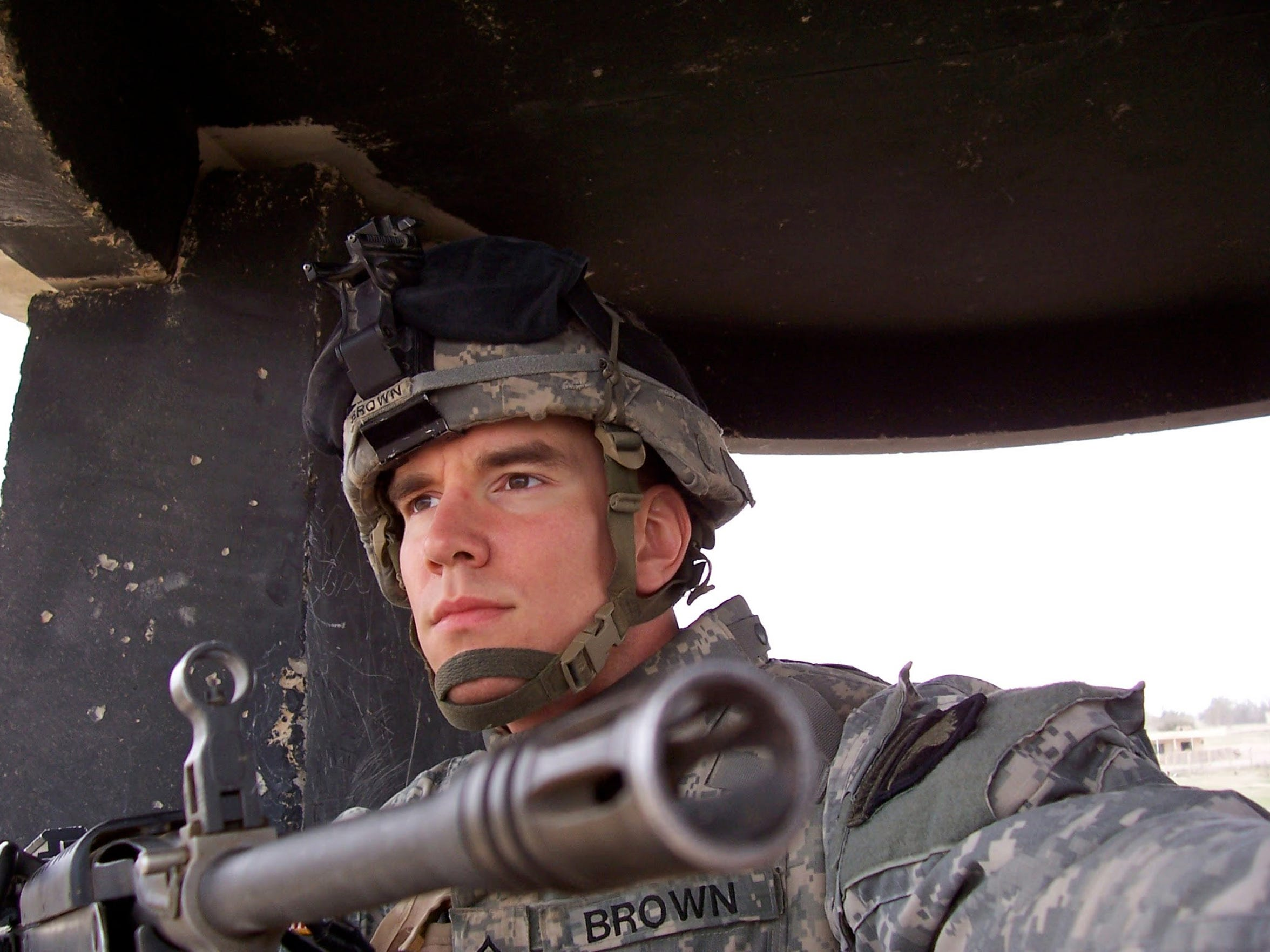 Darren Brown is photogrphed in the gate watch tower at FOB Speicher in Iraq some time in 2006.