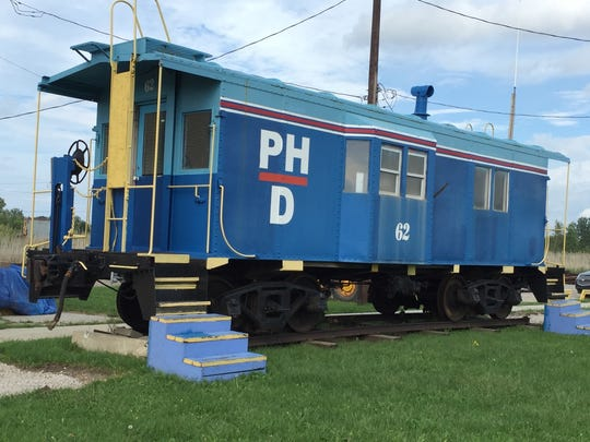 A caboose from the Port Huron and Detroit Railroad is on display at the company's former offices.