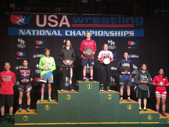 Spring Grove's Kayla Kehr stands on the podium after placing third at the USA Wrestling Cadet National Championships in July.