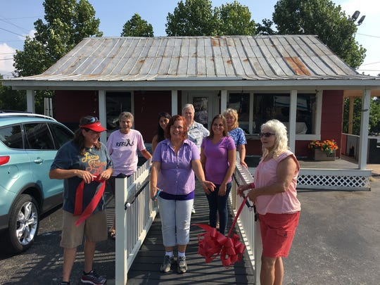 Wendy Liford gets a little help from her family and friends in opening her new flower shop.