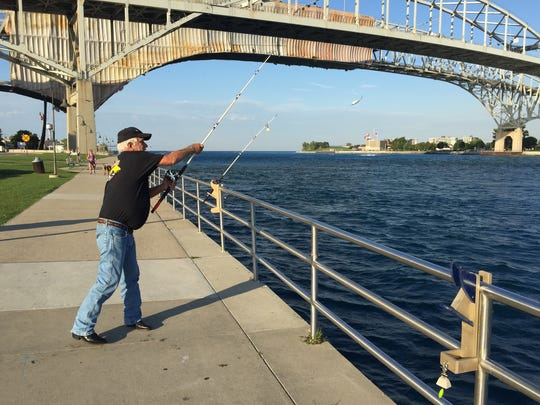 George McLeod, of Clyde Township, casts his lure at