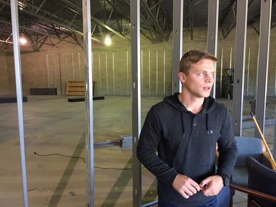 Spencer Olson, youth pastor at Grace Ministry Center, talks about a space in a former strip mall being transformed into a new sanctuary.