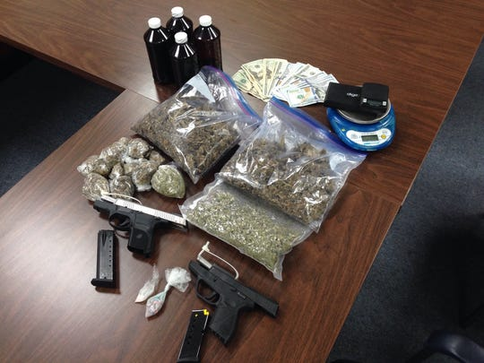 Louisiana State Police conducted a traffic stop Friday in Alexandria that ended up in the seizure of more than 2 pounds of marijuana, 26 Ecstasy tablets, prescription syrups, digital scales, two handguns and $1,700 in cash.