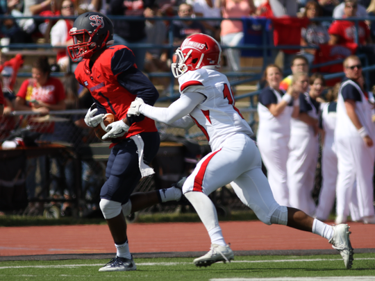 Shippensburg wide receiver Erik Kerns, left, runs into the end zone at the end of one of his two 40-yard TD grabs during the Raiders' win over East Stroudsburg on Saturday.