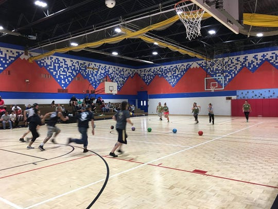Participants at the beginning of a dodgeball match.