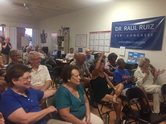 Democrats in Cathedral City cheer on Hillary Clinton during the first presidential debate.