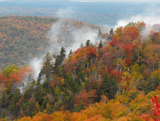 Smoke rises from a forest fire Saturday near the town