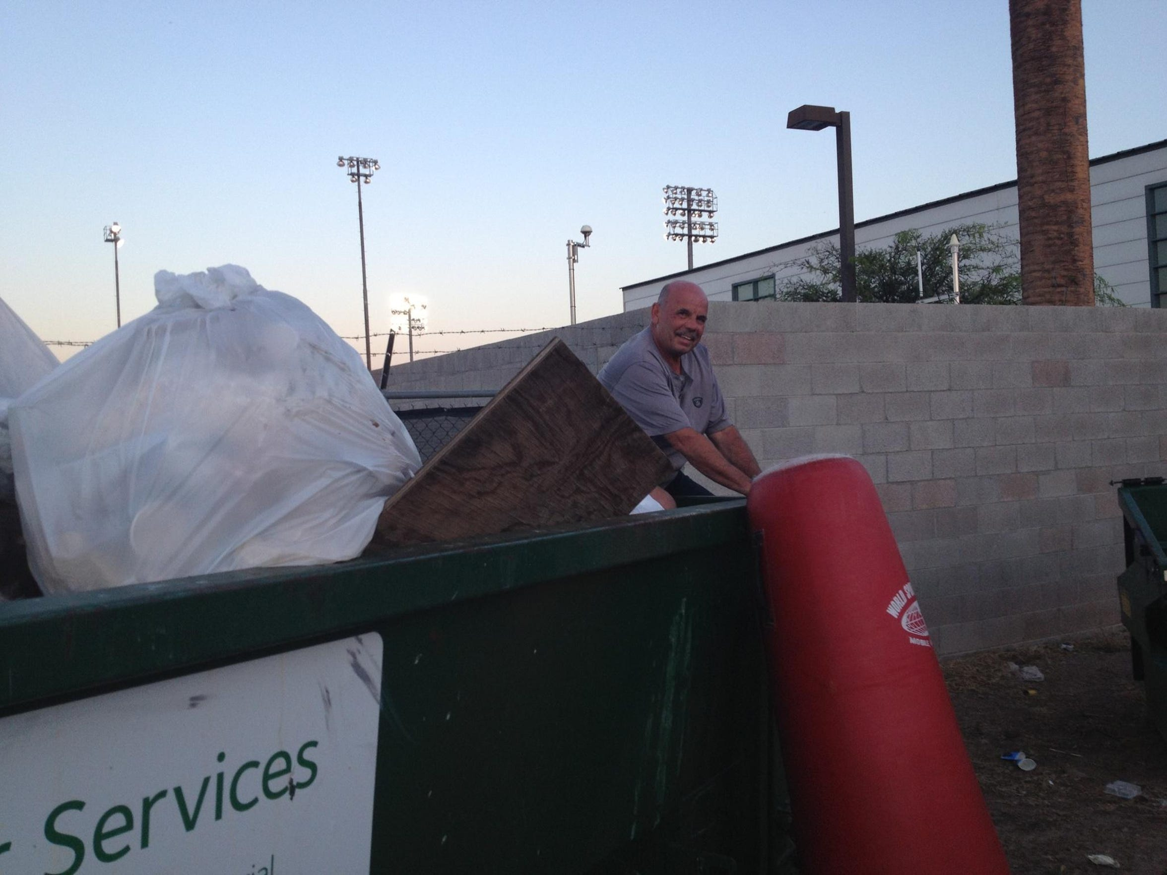 Coach Cozzetto takes equipment for his Phoenix College team at an ASU garbage dump.