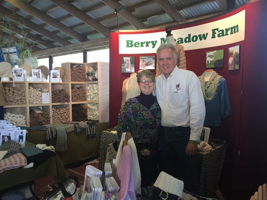 Carol and Kevin Schumann of Berry Meadow Farm were there with new, stackable crates and their array of alpaca and other yarns. They had a lot of customers when I saw them, but Karen managed to get a shot of them together earlier in the day.