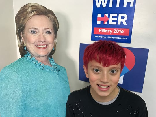 Chris Walker, 10, poses with a cardboard cutout of