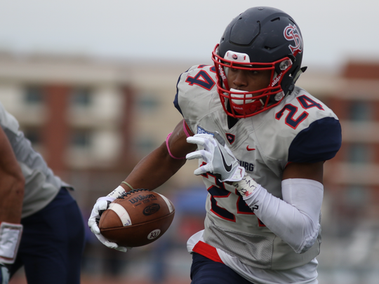 Shippensburg's Kevin Taylor (24) runs back an interception for a touchdown during a PSAC East rivalry game on Saturday, Oct. 29, 2016 at Seth Grove Stadium. Shippensbubrg lost 24-21 to the Golden Bears in double overtime.