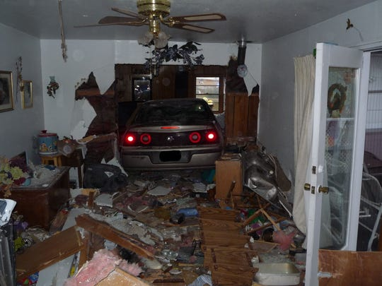 A vehicle barreled into a living room Saturday, Oct.