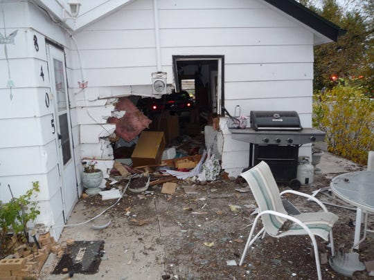 A vehicle barreled into a living room Saturday, Oct. 29, in Black Hawk, SD. Two people inside had minor injuries.