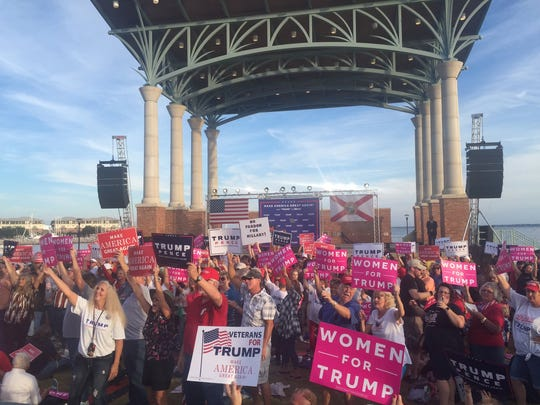Women for Trump stand together at the Donald Trump Rally in Pensacola on Wednesday.
