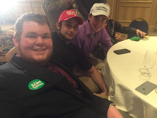 Donald Trump supporters Luke Sheridan, 17, from left, Keagan Landry, 18, and Ian O'Neil, 17, watch election results Tuesday night