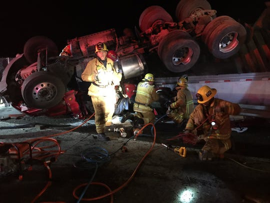 Ventura County firefighters work to extricate a man after a semi overturned Thursday morning on Highway 101 in the Camarillo area.