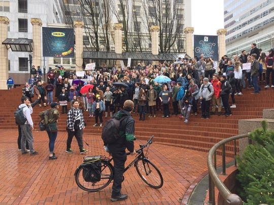 Portland Public School students walk out of classes Monday, Nov. 14, 2016, and converg on Pioneer Courthouse Square for a protest against the results of last week's presidential election, Monday, Nov. 14, 2016 in Poerland.  Hundreds of high school students joined protests in Portland on Monday against Donald Trump's election (Beth Nakamura/The Oregonian via AP)