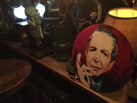 Leonard Cohen watches over the proceedings Monday night