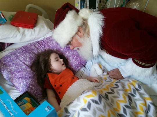 Despite Ivy's hospitalization this week, she got a cheerful visit from Santa.