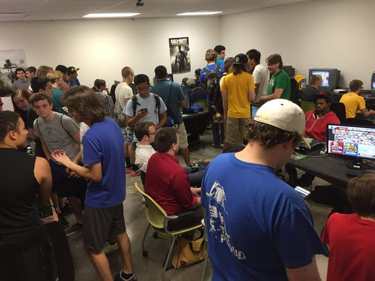 A crowd at a video game tournament at Training Grounds