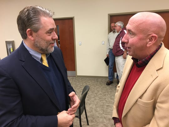 David Graham, right, talks with Jay Albertia, board chairman for Bi-County, at a previous meeting.