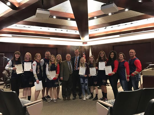 Hurricane's Brenda Christensen, Jennica Gubler, and Mackenzie Jessop pose for a picture after being recognized by the Mayor and Salt Lake City Council for their achievements in wrestling.