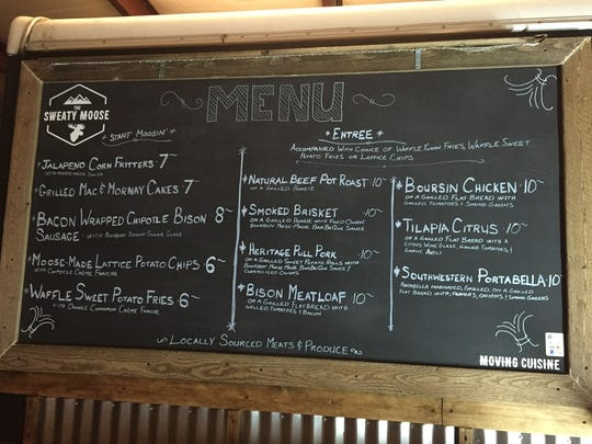 The chalkboard winter menu for Sweaty Moose food truck.
