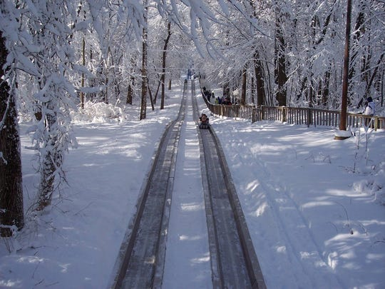 Riders take a sled on the toboggan run at Pokagon State Park near Angola, Indiana, in 2008.