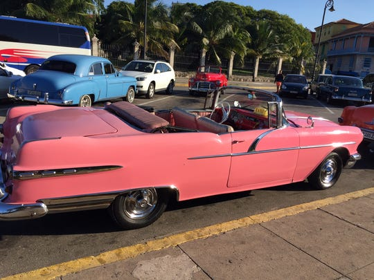 Cuban taxis offer visitors the chance to ride in 1950s American cars.  These old taxis are often driven by doctors and professors who cater to tourists as a way to increase their small monthly salaries.