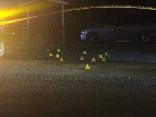 Police officers use cones to mark evidence at the scene