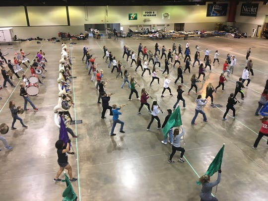 Pulaski High School marching band at Shopko Hall Monday during their final practice before leaving for the Tournament of Roses parade. The parade is Jan. 2 in Pasadena, Calif.