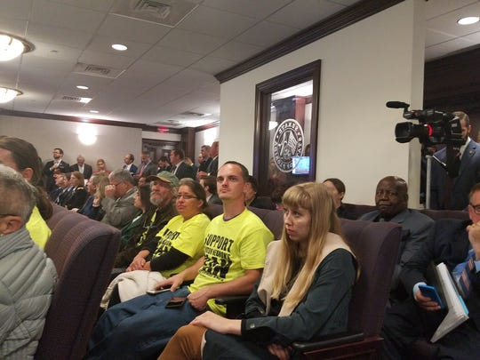 Spectators pack a Senate committee hearing to discuss